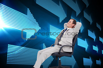 Composite image of side view of businessman leaning back in his chair