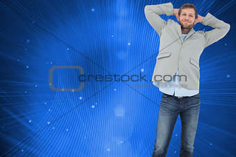 Composite image of suave man in a blazer with hands behind head looking at camera