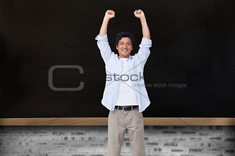 Composite image of cheering male with arms up