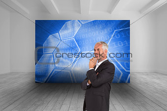 Composite image of happy businessman looking away