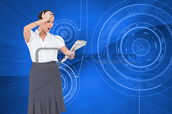 Composite image of surprised classy businesswoman holding newspaper