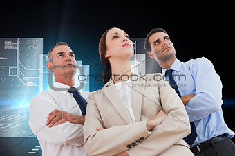 Composite image of serious work team posing together looking away