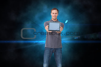 Composite image of young man showing screen of his tablet computer