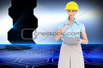 Composite image of thoughtful attractive architect holding clipboard