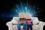Composite image of silly employees with arms folded wearing boxes on their heads