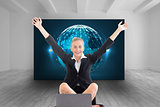 Composite image of businesswoman sitting in front of laptop with arms up
