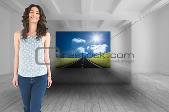 Composite image of smiling beautiful brunette posing