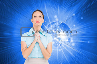 Composite image of troubled young businesswoman praying