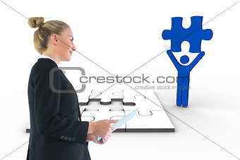 Composite image of businesswoman holding tablet