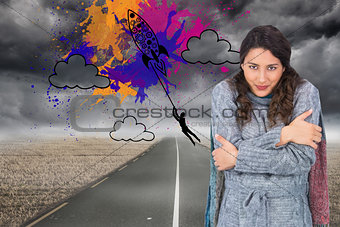 Composite image of peaceful pretty model with winter clothes being cold