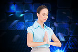 Composite image of peaceful young businesswoman praying