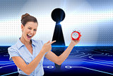 Composite image of businesswoman indicating alarm clock