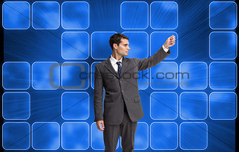 Composite image of stern businessman pointing