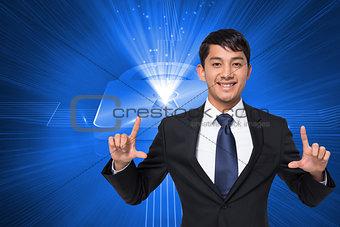 Composite image of smiling businessman holding