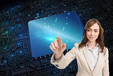 Composite image of portrait of businesswoman touching invisible screen