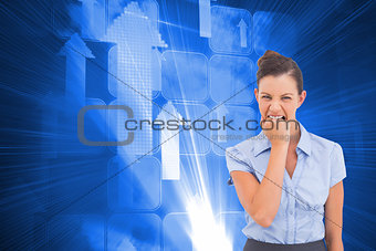 Composite image of furious businesswoman looking at the camera