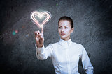Woman Pointing at Glowing Heart