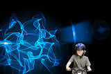 Composite image of little boy with his bike