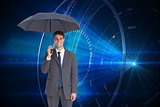 Composite image of happy businessman holding grey umbrella