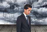 Composite image of serious attractive asian businessman