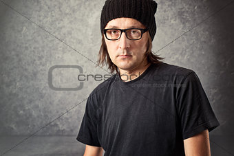 Portrait of Casual Man with Black Cap and glasses