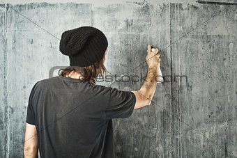 Graffiti artist spraying the wall