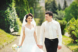 Happy wedding couple walking together