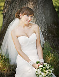Emotional portrait of caucasian happy bride