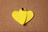 heart shape sticky notes on cork board