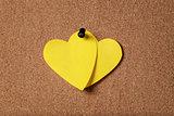 heart shape sticky notes on cork board