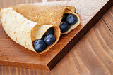 homemade blinis or crepes with blueberries
