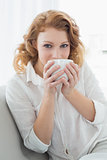Beautiful young female and drinking coffee at home