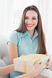 Beautiful brunette receiving a gift box at home