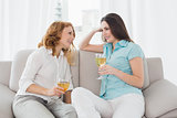 Female friends with wine glasses at home