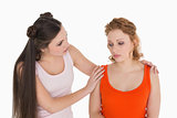 Young woman consoling female friend