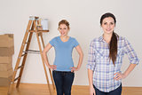 Portrait of female friends standing in a new house
