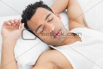 Close-up of a man sleeping in bed