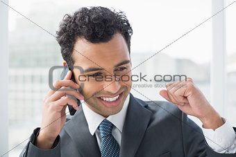Close-up of elegant businessman using cellphone