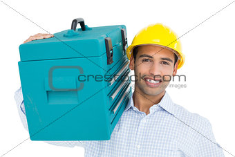 Portrait of a handyman in hard hat carrying a toolbox