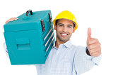 Handyman in hard hat with toolbox gesturing thumbs up