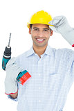 Smiling handsome young handyman in hard had with drill