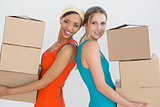 Female friends moving together in a new house