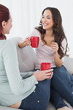 Female friends enjoying a chat over coffee at home