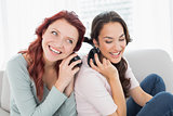 Friends listening music through headphones together at home