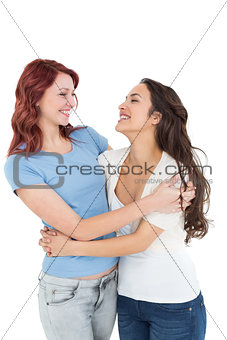 Happy young female embracing her friend