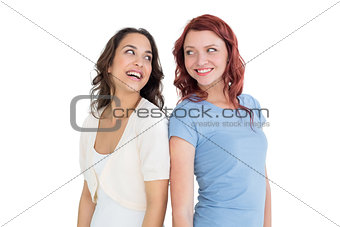 Two cheerful young female friends