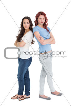 Portrait of two female friends with arms crossed