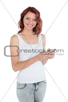 Portrait of smiling casual woman text messaging