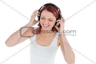 Casual woman enjoying music through headphones