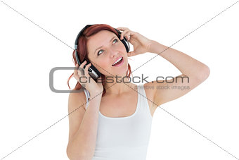 Casual woman enjoying music through headphones